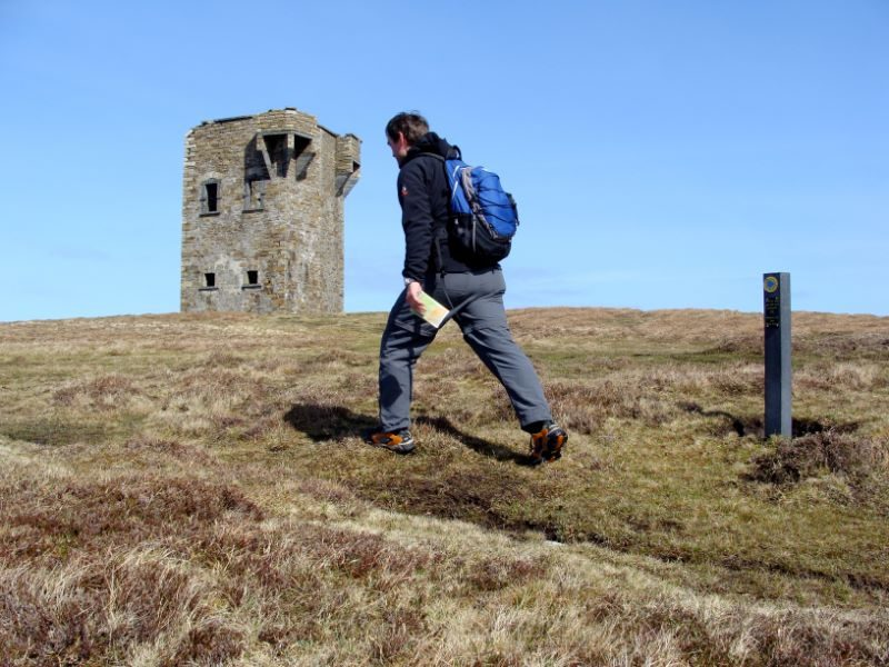 128.-hiker-between-trail-marker-and-signal-tower2